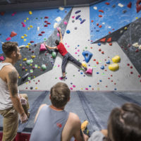 tall climber in red shirt at Inner Peaks Climbing & Fitness Charlotte NC